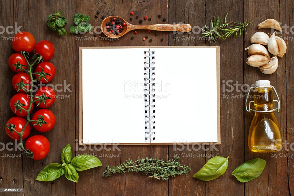 Craft paper with border of vegetables,  herbs and olive oil stock photo