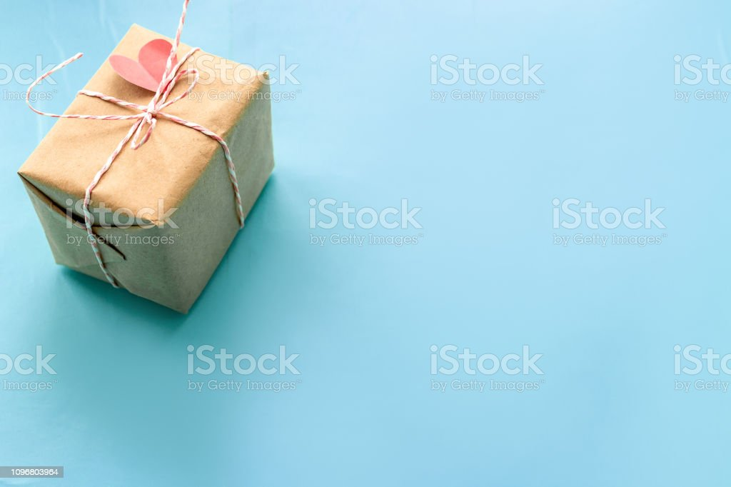 Gift boxe wrapped in kraft paper tied with candy cane Christmas rope...