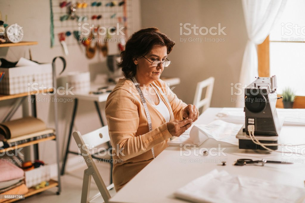 Craft person in her shop