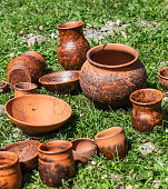 Craft pottery dairy roasting on the grass in the Altai, Russia