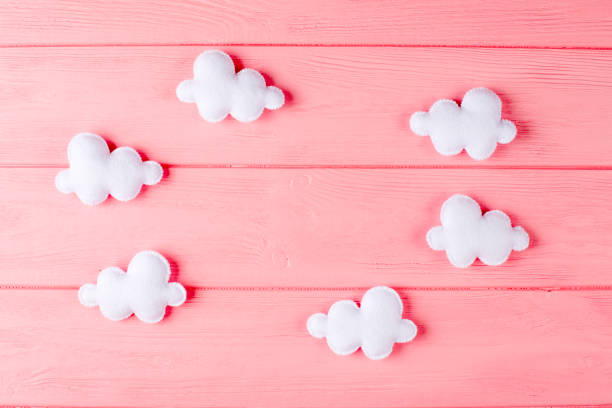 Craft white clouds with frame copyspace on pink wooden background picture id869302814?b=1&k=6&m=869302814&s=612x612&w=0&h=g8qw689q5uitijql1r qxcrh gjbldw3ln3wxipvdmu=
