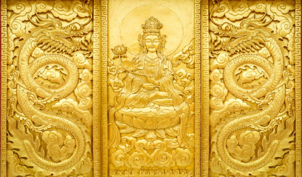 craft wooden with gold color of Guan Yin china god with dragon stock photo