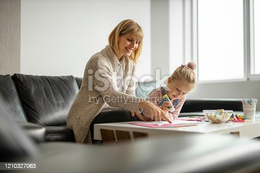 Mother and daughter doing craft work