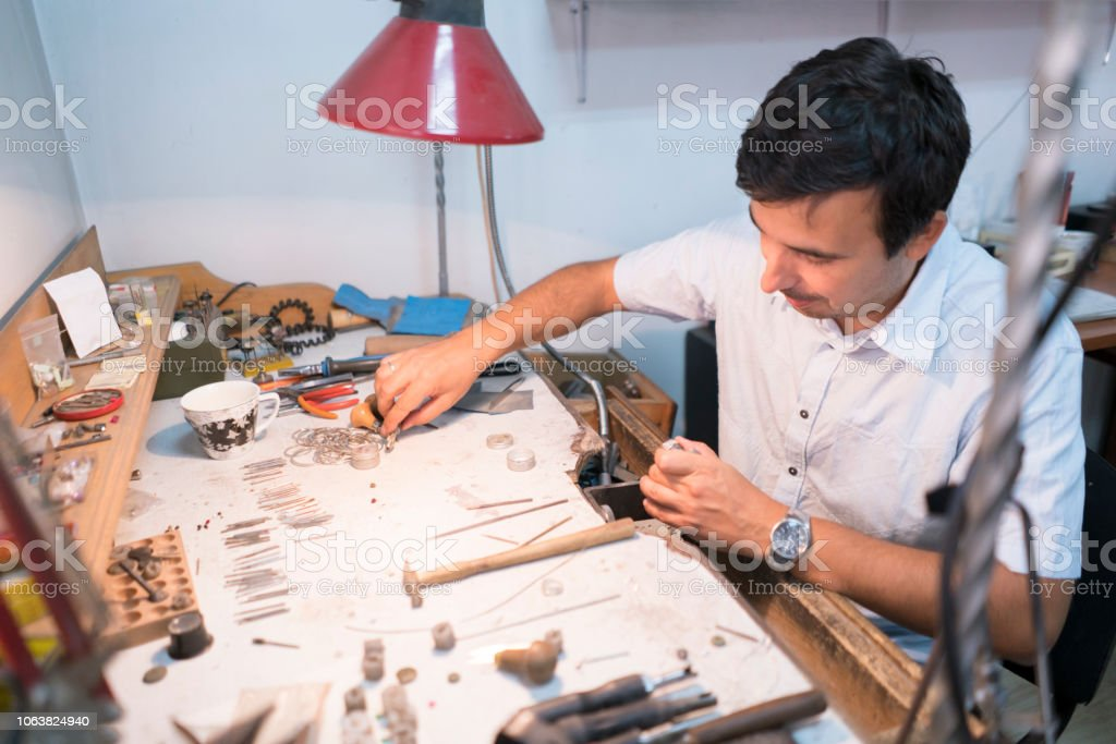 Jeweller working late at his workshop