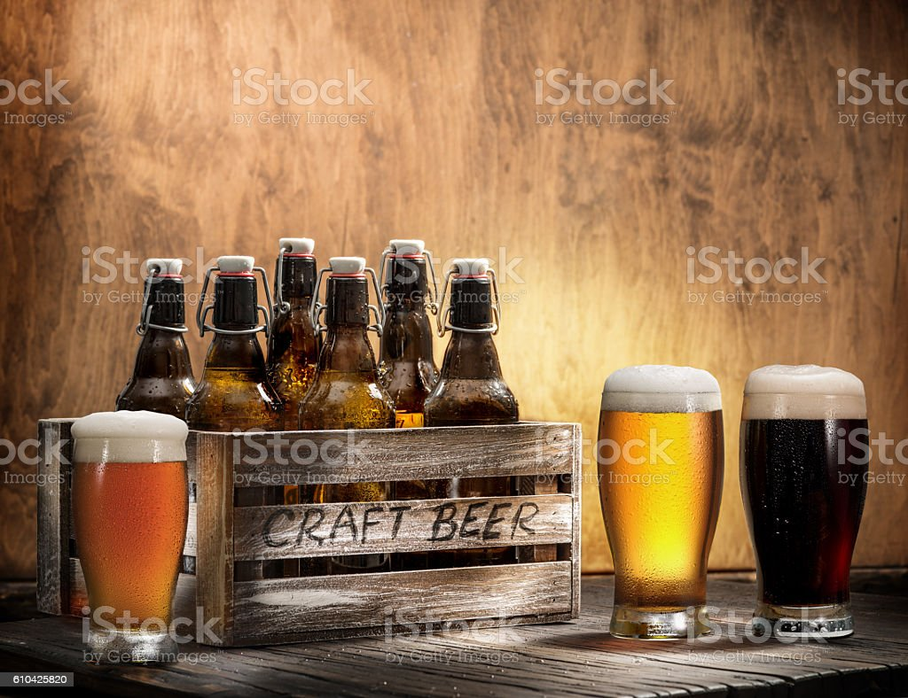 Crafting beer in bottles and glasses. stock photo