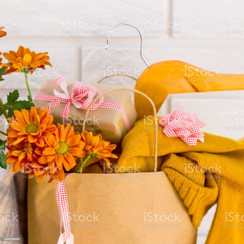 Crafting package with women\'s purchases on a black Friday, filled...