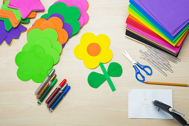 Crafting with foam sheets, scissors and a Hot Glue Gun stock photo