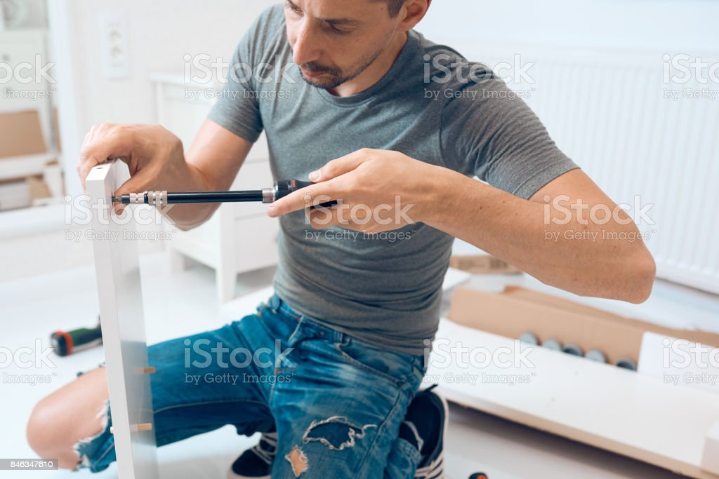 craftman assembleing furniture stock photo