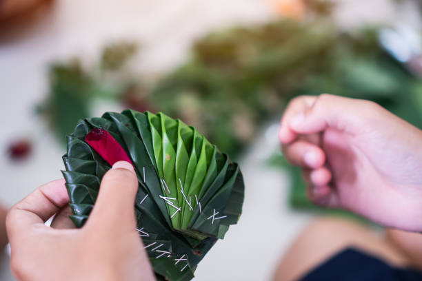 crafts, thai students are learning to make green banana leaves decorated with flowers in secondary schools for loy kratong festival - kratong stock photos and pictures