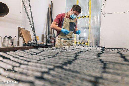 istock Craftsman at the warehouse 1179757078