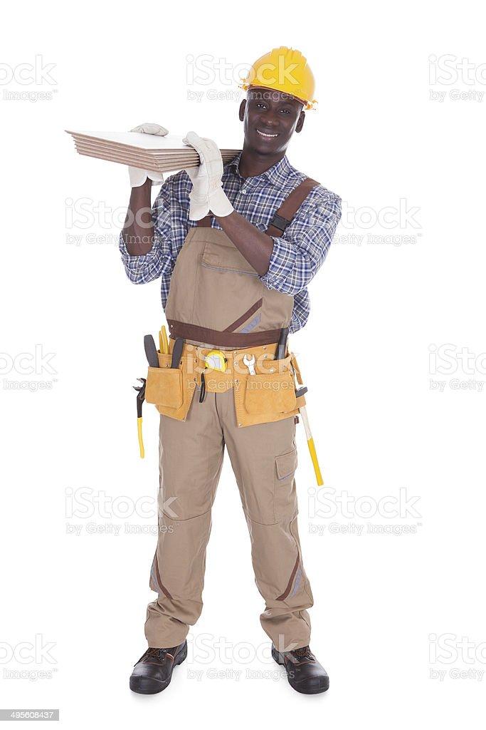 Craftsman Carrying Floor Tiles stock photo