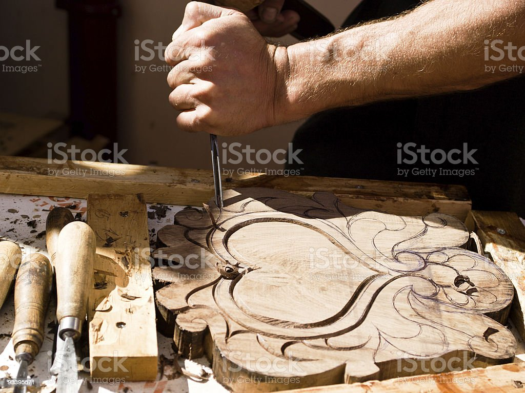 Craftsman carving a souvenir board royalty-free stock photo