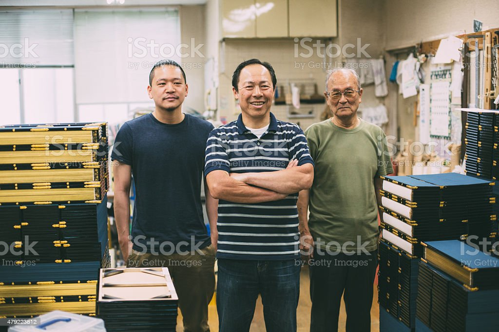 Craftsman family in the studio stock photo