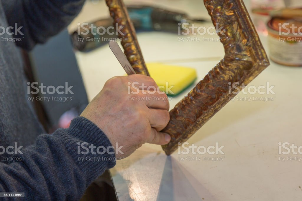 Craftsman Hands Working on Wooden Vintage Frame stock photo