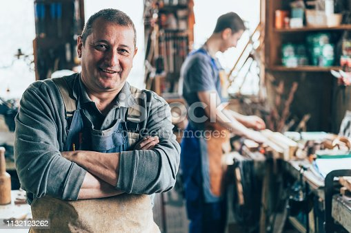 Portrait of Craftsman crossed arms in carpentry workshop