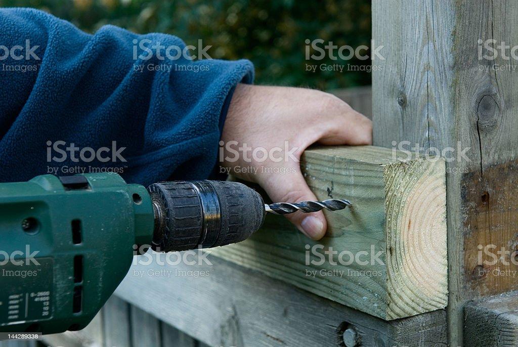DIY craftsman is drilling stock photo