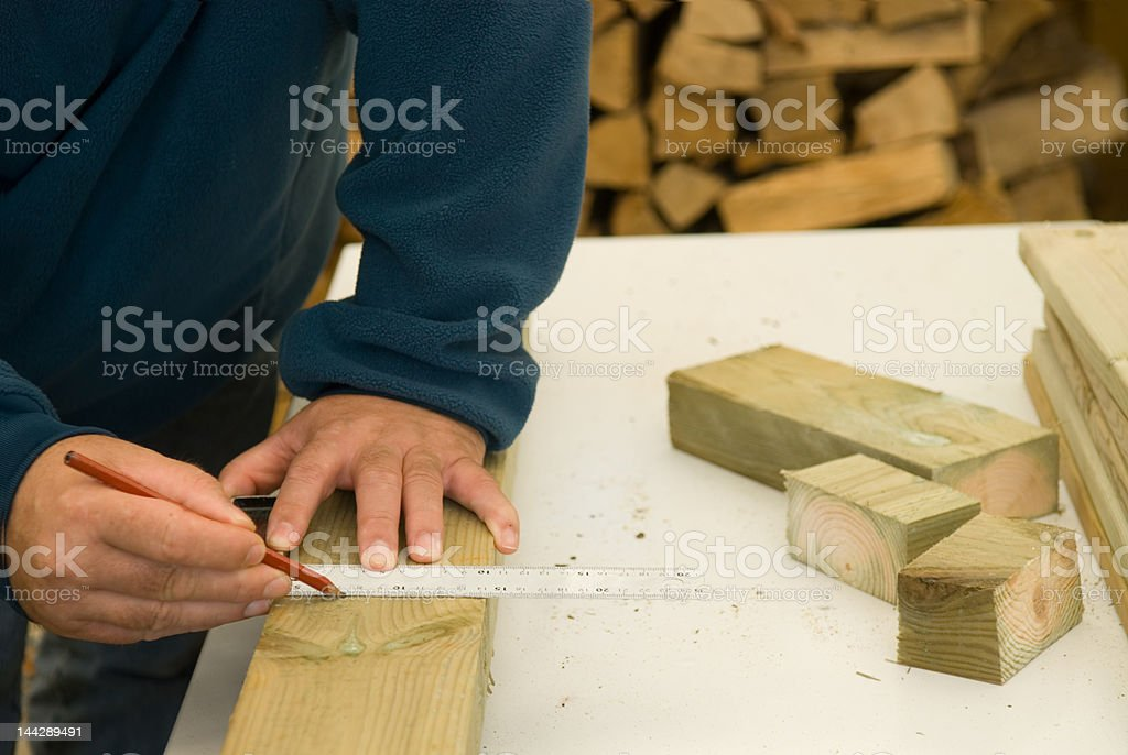 DIY craftsman marks a cutting guide line stock photo