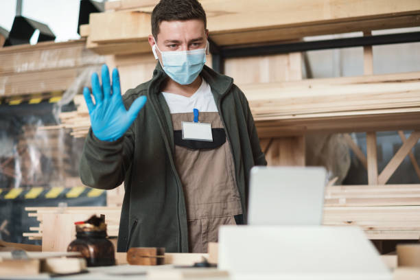 Craftsman talking with clients in video chat during Covid-19 quarantine stock photo