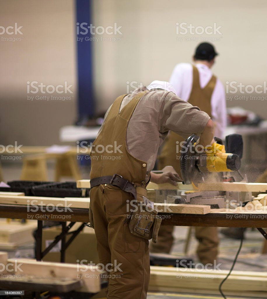 A craftsman working with wood and tools royalty-free stock photo