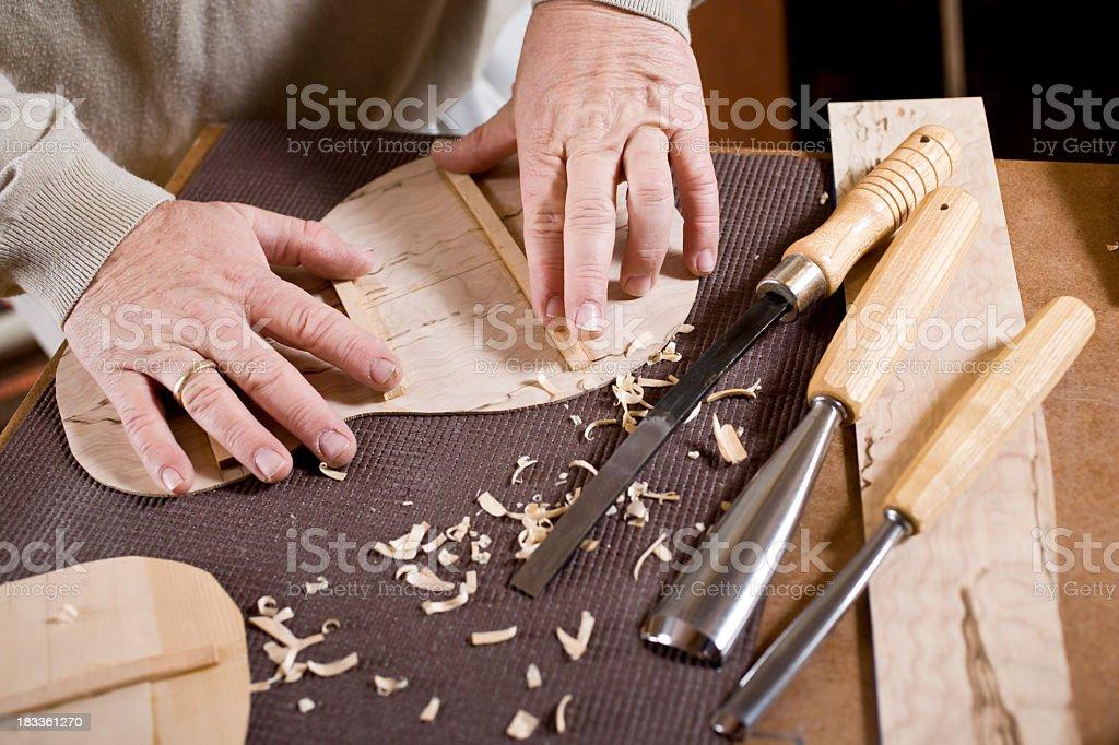 Craftsman's hands, in workshop making violin royalty-free stock photo