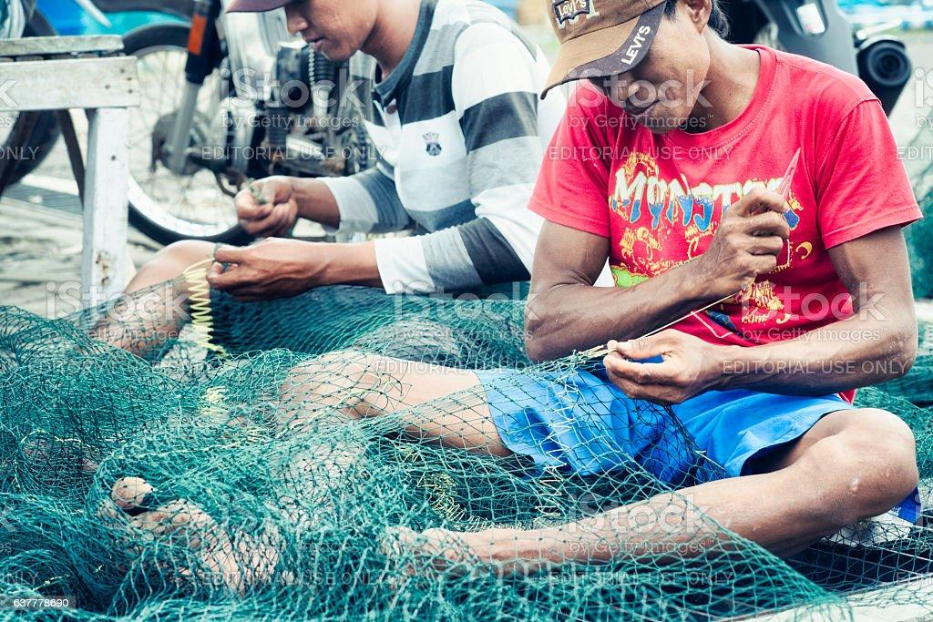 Craftsmen Making Fish Nets in Probolinggo, East java, Indonesia stock photo