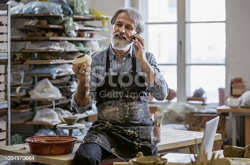 Craftsperson Talking on The Mobile Phone