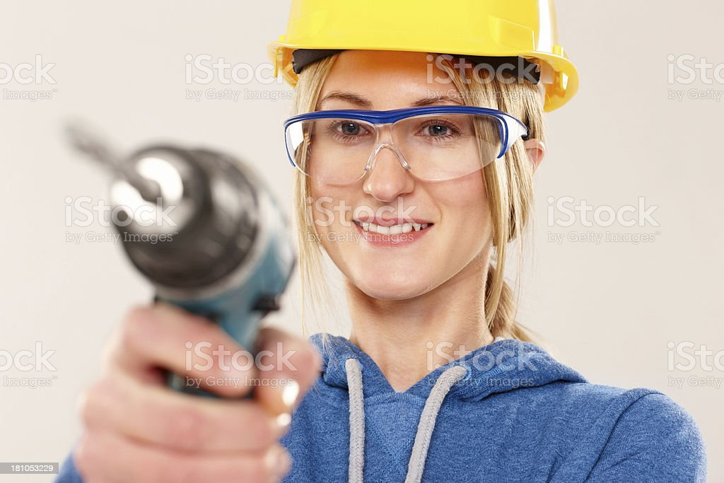 Craftswoman with a power drill royalty-free stock photo