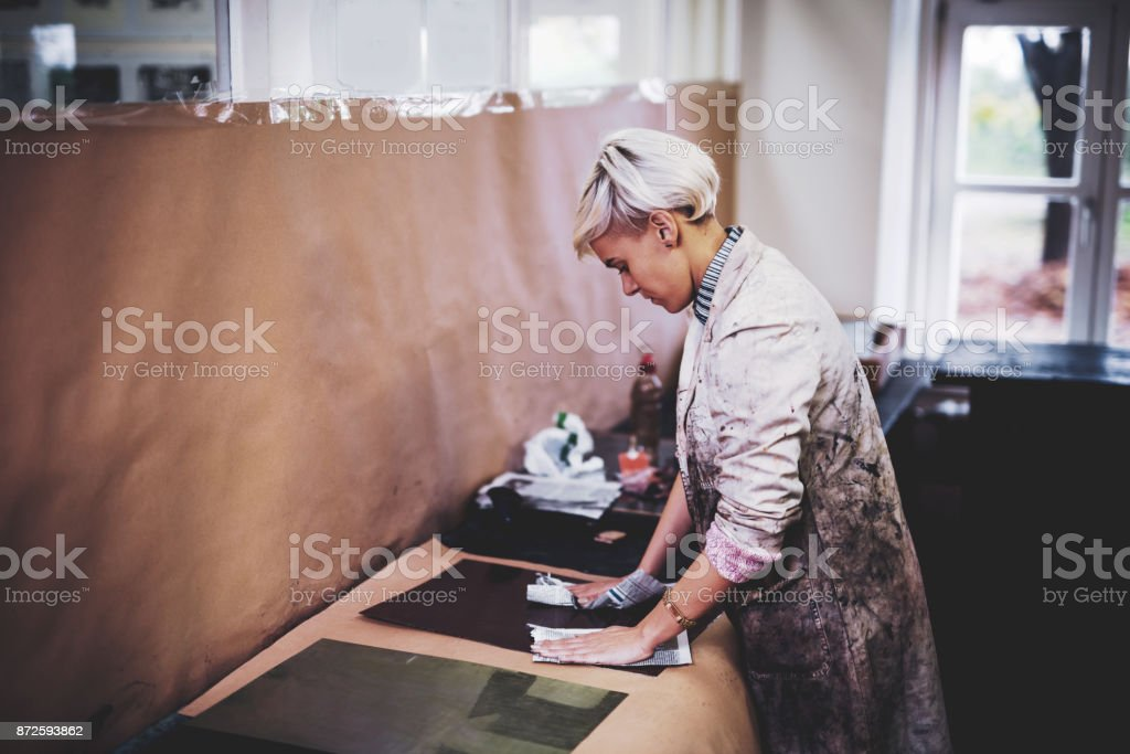 Craftswoman working in workshop and creating new craft products stock photo
