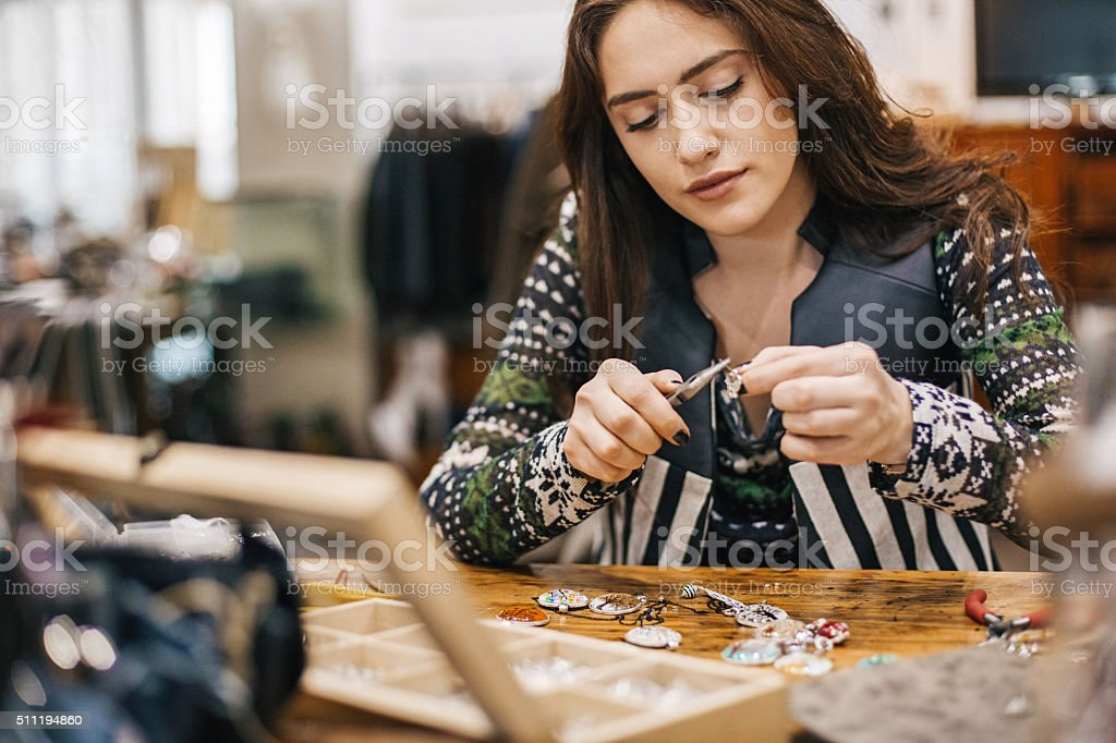 Crafty young woman stock photo