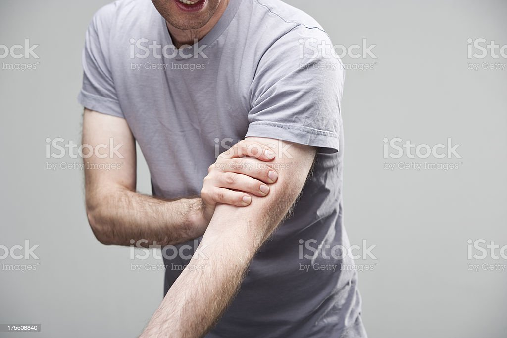 Cramp in arm stock photo