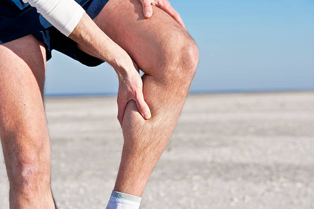 "Cramp in calf ""A male jogger, having a cramp in his calf."" calf stock pictures, royalty-free photos & images"