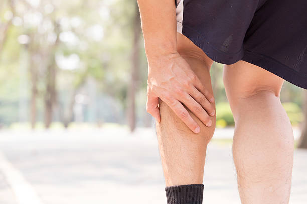 cramp in leg while exercising. sports injury concept - kramp bildbanksfoton och bilder