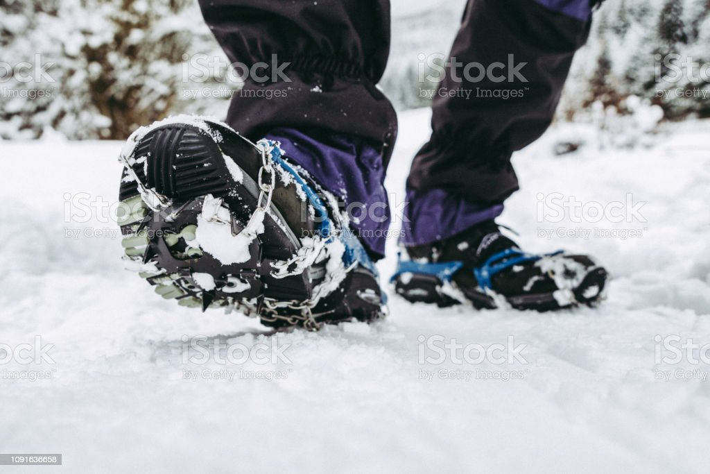Crampons on hiking boots stock photo