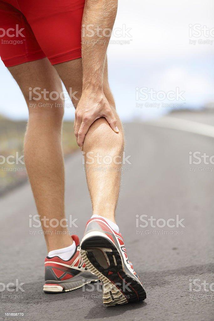 Cramps in leg calves royalty-free stock photo
