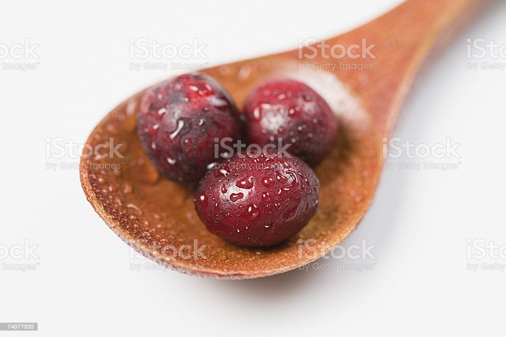 Cranberries on a spoon royalty-free stock photo