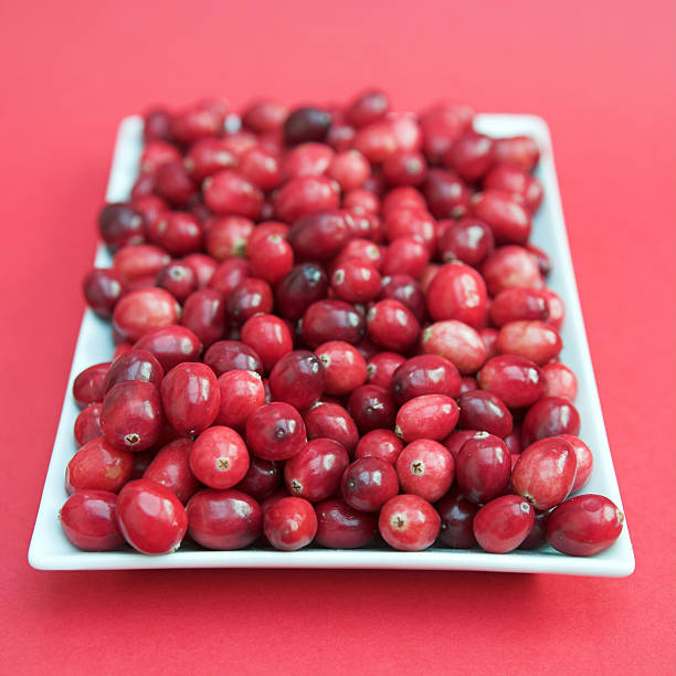 Cranberries on a white plate stock photo