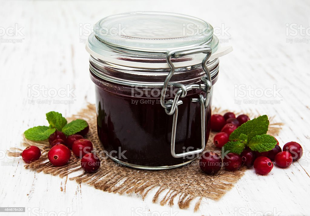 cranberry jam with fresh fruits stock photo