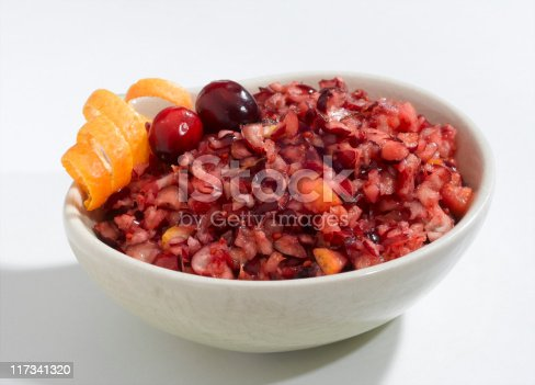 A cranberry orange relish in a while bowl.