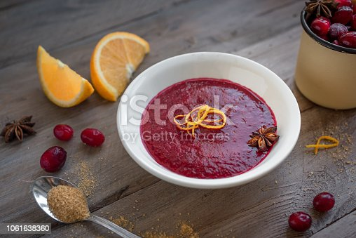 Homemade Cranberry Orange Sauce (Relish) for Thanksgiving or Christmas on wooden, close up. Traditional festive Cranberry Sauce with ingredients.