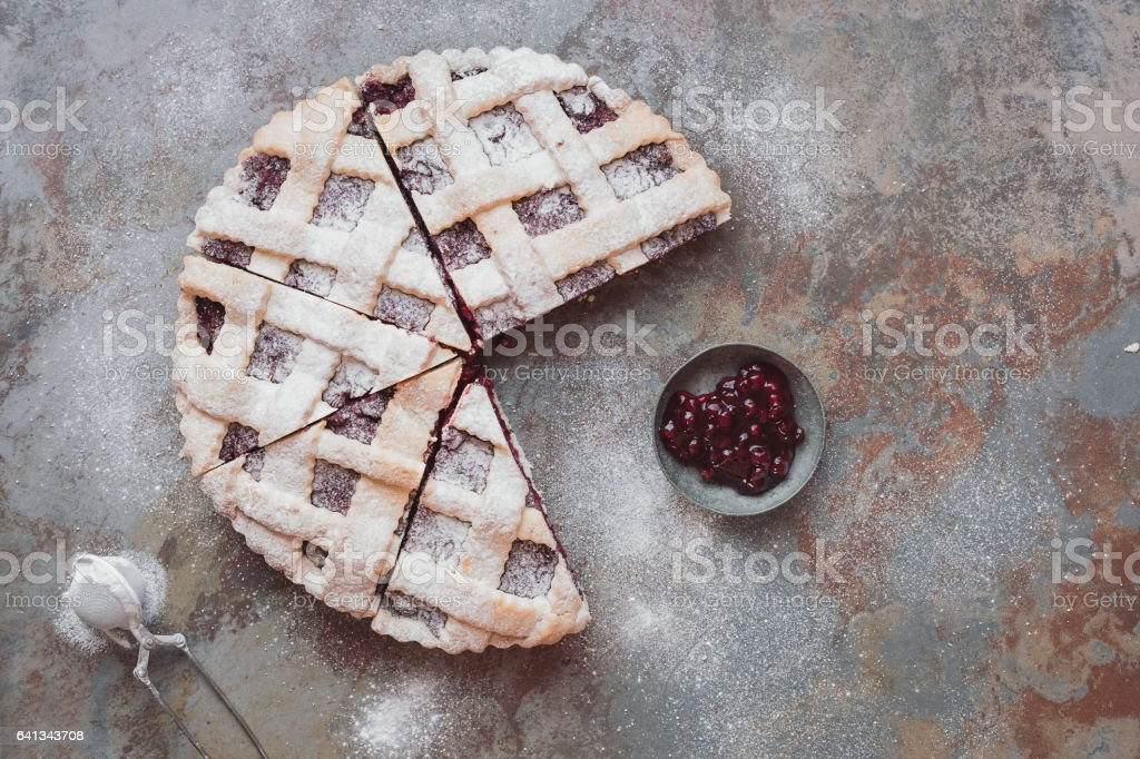 Cranberry pie with lattice top and jellied fresh cranberries stock photo