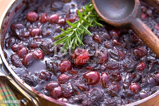 Cooking holiday dinner cranberry sauce: Fresh rosemary & cranberries. (SEE LIGHTBOXES BELOW for more Thanksigivng, Christmas cooking & food backgrounds...)