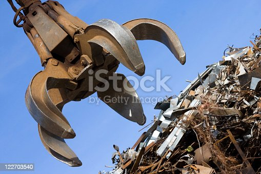 istock A crane about to grab sheet metal 122703540