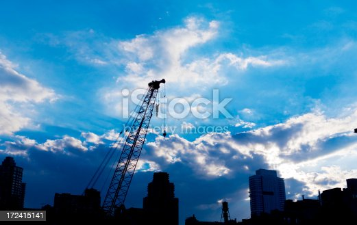 Beautiful blue sky with rays of light, while the city stirs beneath.