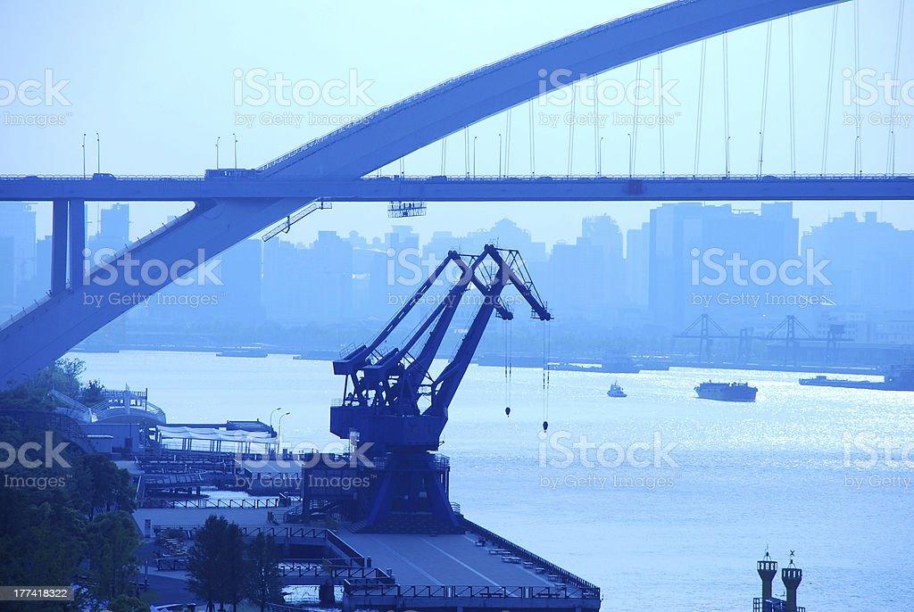 crane and bridge in city stock photo