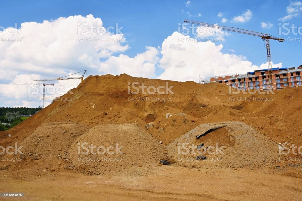 Crane and construction of new buildings. Beautiful background for the construction industry at sunset. royalty-free stock photo