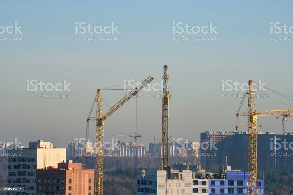 Crane and construction site against blue sky in the morning stock photo