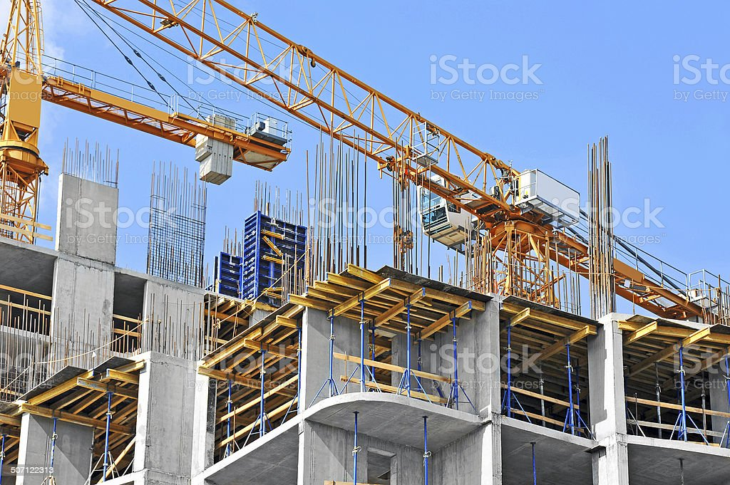 Crane and construction site​​​ foto