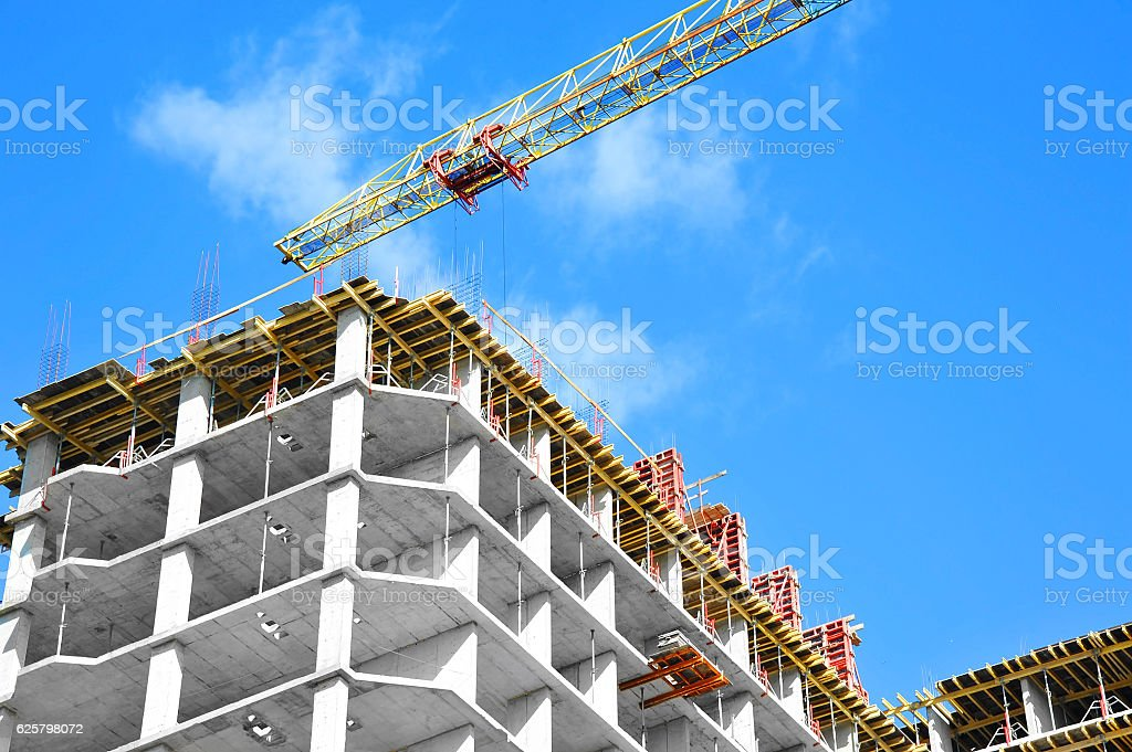Crane and highrise construction site stock photo