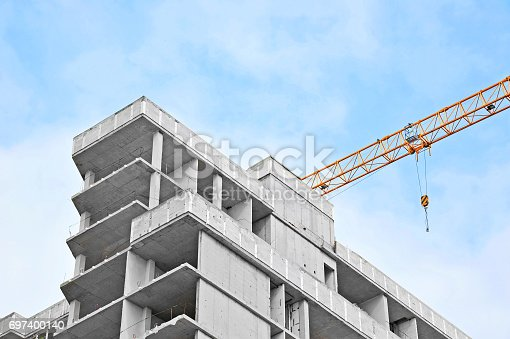 istock Crane and highrise construction site 697400140