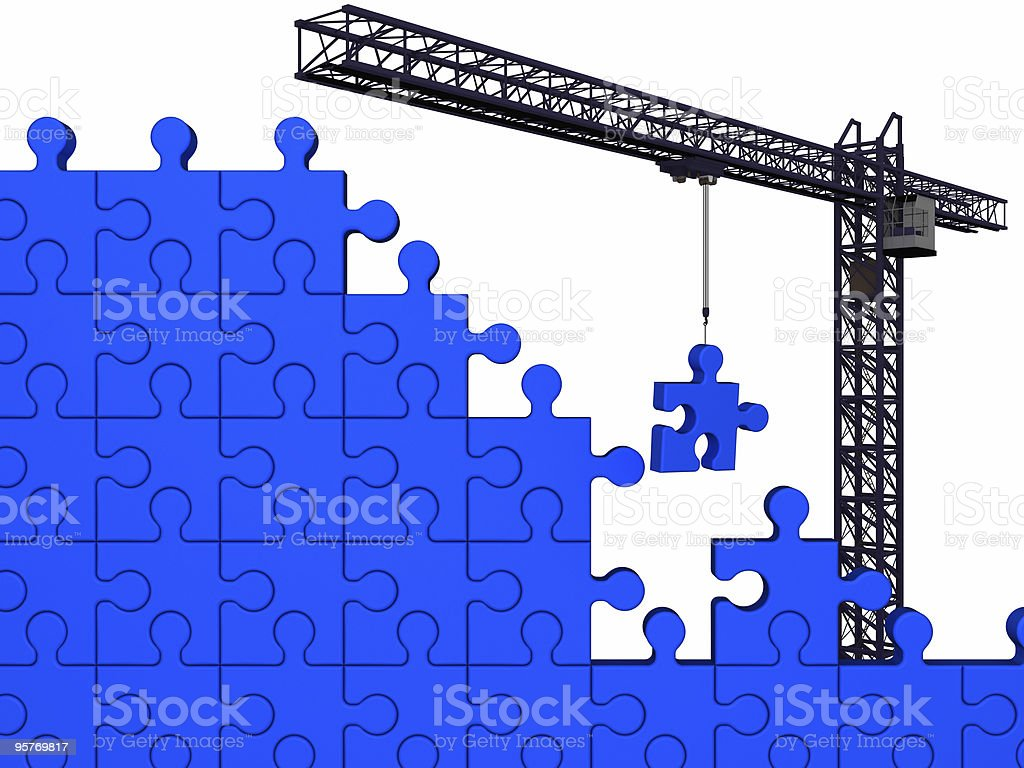 Crane and puzzle royalty-free stock photo